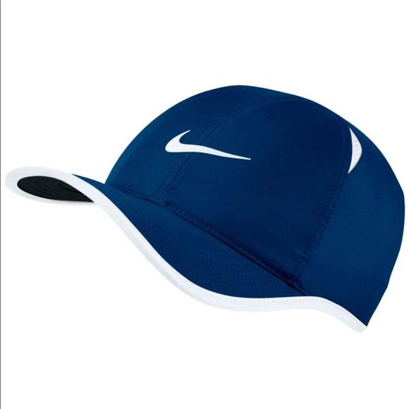 e180afdc5ed NIKE AeroBill Featherlight Cap Hat